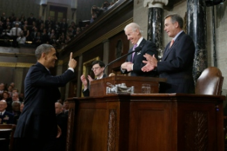 U.S. President Obama gestures toward Vice President Biden and House Speaker Boehner prior to delivering his State of the Union speech on Capitol Hill in Washington